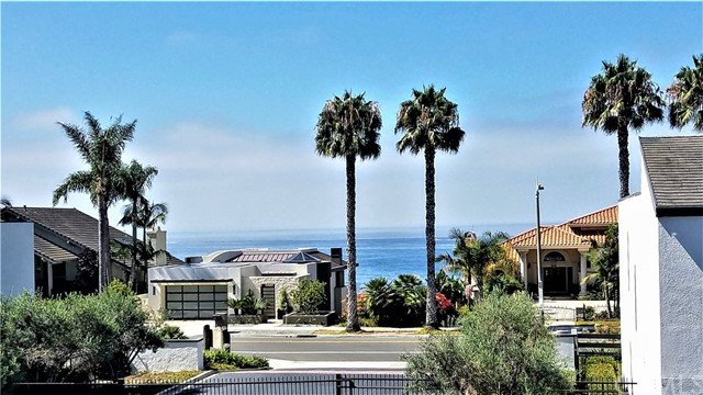 Location, Location, Location!   Fabulous Camino Capistrano Condo with Ocean Views from both levels includes three bedrooms, updated kitchen, huge master retreat and attached two-car garage.   The gated development of Marbella Racquet Club includes a beautiful association pool/spa area plus private tennis court, all across from the famous Capistrano Beach bluff overlooking the gorgeous Dana Point Marina.  Enjoy two private ocean view decks --one from the dining room and one from the master.  Inside second floor laundry hook-ups are available.   This location boasts wonderful walking trails with access to the shoreline and nearby shopping opportunities.  Award-winning schools make this a highly desirable Capistrano Beach location with nearby Pines Park.