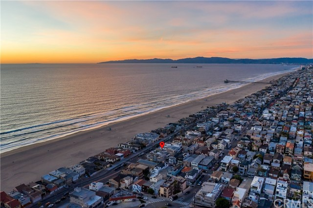 PHOTOS DO NOT DO THE VIEWS JUSTICE. THIS HOME HAS UNBELIEVABLE OCEAN VIEWS FROM PV TO MALIBU. Some of the Best Views in Town are on Hermosa Ave, North of 28th street, Where the Lots Sit Up Higher on the East Side to Enjoy the Panoramic Ocean Views to the West Over the 25 Foot Height Limit on the Strand. The Property Sits EAST / WEST  Oriented so the Flow of the Home Can Be Fully Focused Right Where it Should Be: On the Sparkling Pacific Ocean.  Located in the heart of a classic coastal neighborhood, this modern beach house is a nucleus for family and friends. This peaceful retreat unfolds to reveal a thoughtful balance between indoor and outdoor living with many unexpected features. Relaxed but refined, crisp but inviting,the casual elegance of this purposeful environment embraces an active beach life where sun, sand,ocean views / breezes, and memories are closely interwoven. Features of the home are•As Good As It Gets Panoramic Ocean Views•Michael Lee Design in 2000•Gourmet Kitchen with Viking Stainless Steel Appliances•Ocean View Master Suite with Large Walk In Closet and Spa like Bath•2 Garages and too Many More Upgrades to Mention. Come See For Yourself.