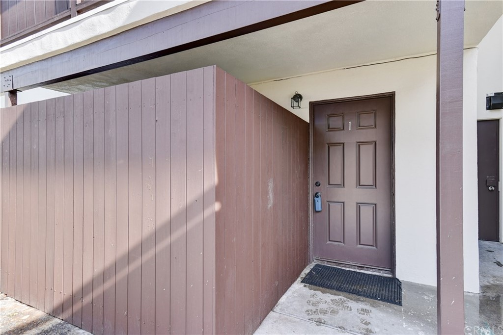 Nicely upgraded 3 bedroom and 2 bath lower unit.  Has new floors, new blinds, new windows, new slider, new appliances including a microwave and recently has been painted. Patio off the living room.  Close to shopping and dining.  Located on a cul-de-sac street.  Conveniently located assigned parking.