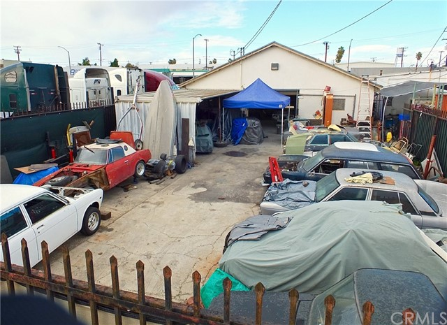 Back lot is currently being used by a car guy along w/ back of building