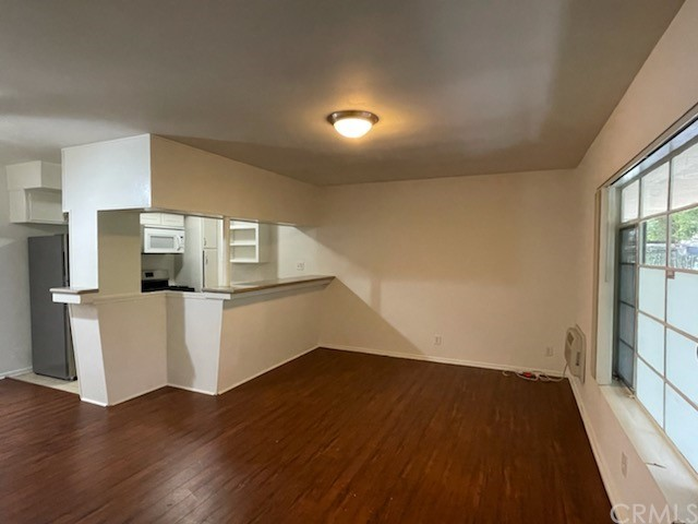Ground Floor Apartment Laminate Flooring Carpet in Bedrooms Wall Unit AC / Heater Granite Counter top Ceiling Fan Fridge, Stove, Dishwasher, Microwave 2 Parking Spots Laundry on Premises Water & Trash Paid One year lease Will consider one small pet