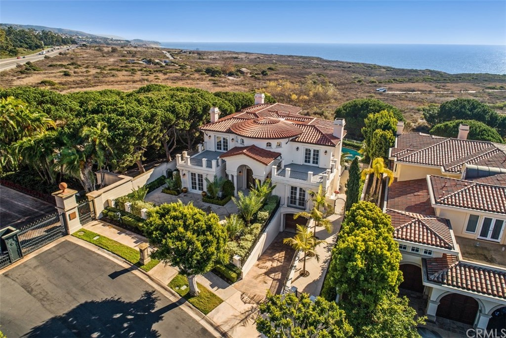 FROM THE MOMENT YOU SEE THE GRAND ENTRY WITH ITS GLISTENING CHANDELIERS AND SWEEPING STAIRCASE, IT'S CLEAR THIS IS A HOME THAT WILL DELIGHT THE SENSES. MEDITERRANEAN-INSPIRED AND CUSTOM-BUILT TO MAKE THE MOST OUT OF THE SWEEPING OCEAN VIEWS, NO DETAIL HAS BEEN OVERLOOKED IN THE CREATION OF THIS NEWPORT COAST RESIDENCE SHOWCASING UTTER OPULENCE AND SOPHISTICATION.