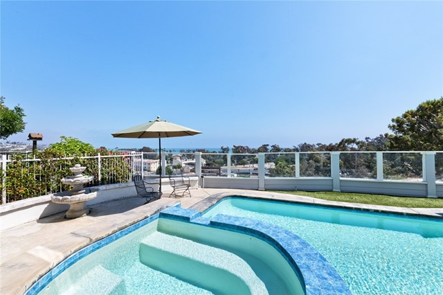 Enjoy panoramic sit-down ocean views down to San Clemente from all three levels of this wonderful Dana Point home. Sit on one of the ocean-view decks and sip your morning coffee or late afternoon cocktails while watching the boats drift past. Swim laps in the solar heated saltwater pool or take a dip in the spa after a day at the beach. Walk down to the harbor for dinner and peruse the shops. Life could not be more enjoyable than in this four bedroom, four and one-half bath home on a small cul-de-sac in the Village At Dana Point. The moment you walk through the front door you will want to stay forever. With high volume ceilings and plenty of light, this home also boasts a formal dining room with a wine refrigerator and wet bar; a lovely family room, an eating area in the kitchen and all of the bedrooms and baths are ensuite. This home can be leased either furnished or unfurnished for your stay of six months or longer.