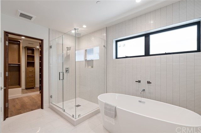 Thoughtfully crafted and stylishly appointmed boutique styled closet and decadent spa like bath