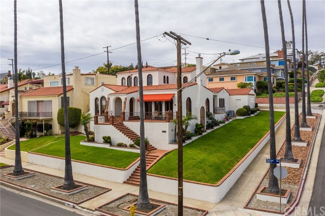 Once in a lifetime opportunity to own a historical Spanish Revival with Panoramic Harbor and City Lights Views that was custom built in 1926 for the current owners family. The home has undergone an extensive restoration while maintaining the original character and charm with modern amenities. Entering the home you are greeted by a two story sun filled entry with a sweeping staircase. Enjoy the beauty of the step down grand piano size living room and formal dining room. This beautiful home features the original gumwood fine woodwork, arched French doors, crystal door knobs, coved ceilings, a stunning batchelder style tile fireplace, original ironwork, lighting fixtures and hardwood floors. Modern upgrades include a large chef's island kitchen, a private master suite retreat offering a luxurious master bath with spa tub, dual vanities and separate shower. Additional features include forced air heating, dual zone central air conditioning, updated plumbing and electrical. The private rear yard features a covered patio, outdoor fireplace, built-in barbeque and bar area. Just minutes to the harbor, Cabrillo Beach and shopping. Walk through this home virtually room by room from the comfort of your couch at: https://my.matterport.com/show/?m=XqH15BAcYHx&brand=0 or click on the virtual tour icon above.