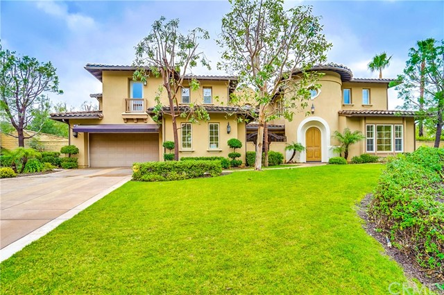 Elegant & luxurious this Padua Hills home is ideally located in Stone Canyon Preserve. Offering 4 bedrooms & 5 baths, find plenty of space for the whole family. Inside, an impressive foyer with lofty ceiling and gorgeous chandelier offer a warm welcome. Wonderful for entertaining, sit for cocktails in the inviting formal living room then gather for dinner in the elegant formal dining room showcasing lovely views of the gardens & French doors leading out to the interior patio. The open concept main livingElegant & luxurious this Padua Hills home is ideally located in Stone Canyon Preserve. Offering 4 bedrooms & 5 baths, find plenty of space for the whole family. Inside, an impressive foyer with lofty ceiling and gorgeous chandelier offer a warm welcome. Wonderful for entertaining, sit for cocktails in the inviting formal living room then gather for dinner in the elegant formal dining room showcasing lovely views of the gardens & French doors leading out to the interior patio. The open concept main living area is centered around the interior patio so lovely views can be enjoyed from both sides of the room. Gather with friends in the grand, two story family room with regal second story overlook & cozy fireplace. The gourmet chef's kitchen is complete with attractive cabinets, matching appliances, granite counters, large center island/breakfast bar, butler's pantry & separate walk-in pantry. The luxurious, private master invites you to pamper yourself boasting a cozy sitting room with minibar & fireplace, two walk-in closets, & spa style bath with dual vanities, walk-in shower & soaking tub. Downstairs the spacious office can also be converted to a fifth bedroom. Outside, find the perfect retreat. Unwind out on the spacious patio with summer kitchen, lush landscaping & beautiful green lawn. Also enjoy a laundry room & large 4 car garage. Ideally located in a top-rated school district, close to walking trails, & Claremont Village.