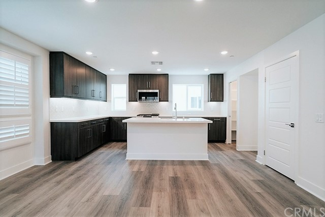 Dining Area to Kitchen with Quartz countertop island