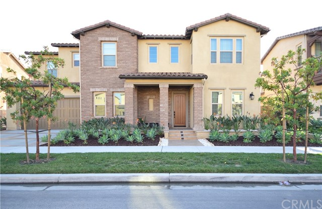 "Welcome to Tustin Legacy!  Beautiful home is better than new built in 2016 with a fantastic floor plan.  Well suited floor plan is perfect for entertaining and living.  Expansive great room opens out to the gourmet kitchen with tranquil views of the outdoors.  Separate casual living room is perfect for family game time.  Gorgeous kitchen is oversized w/ large center island, sunny eating area, and walk in pantry.  KithchenAid Stainless Steel Appliances, Commercial Style 48"" 6 burner gas stove, double built in oven, full capacity built in microwave and full back splash in kitchen.  Functional floor plan is perfect for multi generational living w/ the main floor suite.  Suite is  like a studio, w/ living space, kitchenette area, walk in closet and in suite bathroom.  Escape upstairs where an additional bonus area awaits.  Good size master suite is complete w/ a large balcony where you can enjoy sunset views.  Master bath offers resort style layout w/ large shower, & soaking tub.  Greenwood in Tustin Legacy offers homeowners the best of family life and neighborhood connectivity through magnificent community amenities. Enjoy a walk able neighborhood atmosphere and easy access to shopping & dining at the District, local beaches, freeways, and John Wayne Airport. Trails, Parks, & Open Spaces, picnic pavilions, sport ll courts, play areas, Clubhouse with catering Kitchen, covered outdoor living space, Resort-style pool and spa, interactive water play area, Fire pits and barbecues."