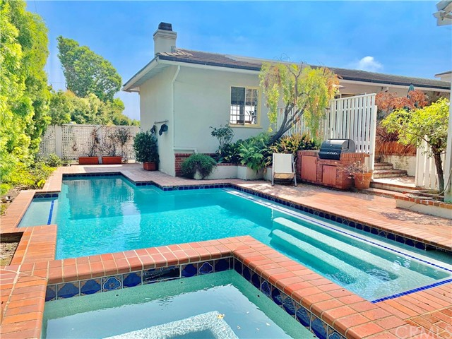 Charming traditional CITY and OCEAN VIEWS ONE STORY HOME, quiet location on Franklin St. sited on a generous 10,500+ square foot lot! Great opportunity to Remodel, renovate or develop new. The main level master suite faces a large, private, and tranquil courtyard that leads you to a sparkling pool/spa. Updated kitchen open to great room filled with natural light and city views. Second story office with a beautiful PANORAMIC VIEW and 1 bedroom at basement level. Fenced in and elevated front yard surrounded by mature landscaping. Stellar location near all amenities in Santa Monica and Brentwood. An incredible opportunity not to be missed!