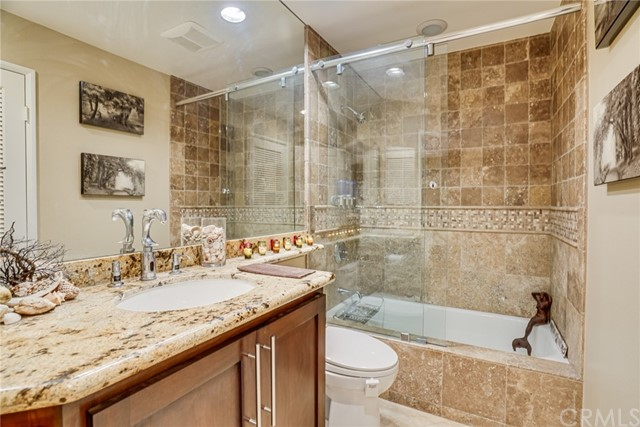 The Guest Bath has Lovely Ocean Themed Fixtures and Tile, Do you See the Dolphin?