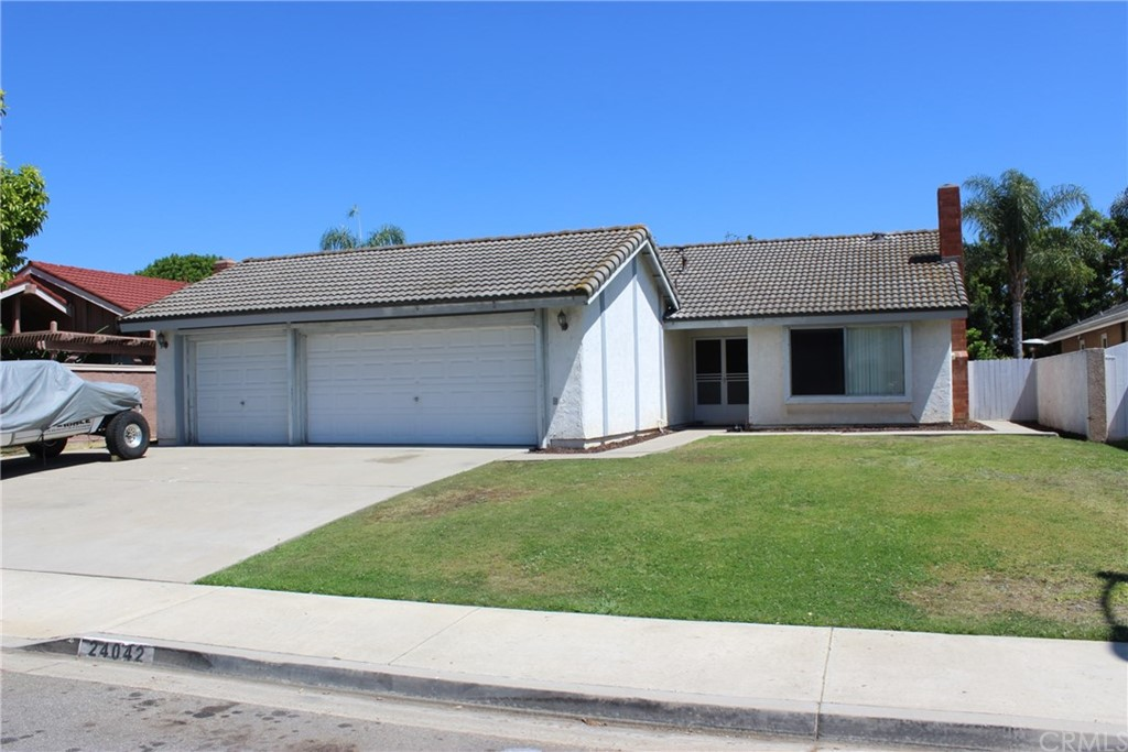 Great opportunity for someone who wants large pool size lot and plenty of places to have cars and trailers. 3 Bedrooms, 2 Baths, and a 3 car garage with a pass through garage door into a side area for extra vehicles or a trailer. The rear yard has a huge patio and fruit trees, block wall fences, and a large storage shed on the side yard. Tile flooring in the living room, country kitchen, dining area, laundry room, and hallways. The kitchen has newer cabinets and granite counters and the bathrooms have newer vanities and the master shower has been redone. The property also has inside laundry, tile roof, bedrooms have scraped ceilings, and the garage has been drywalled & insulated, pass through garage door, and a large attic storage space has been built. No HOA dues and no Mello-Roos.