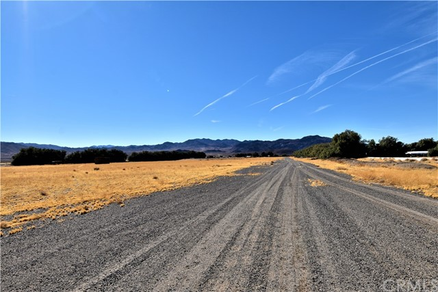 Gravel road used as an air strip for a Cessna