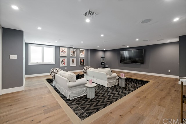 Fully equipped in-home movie theatre/media room with sunken living room feature.