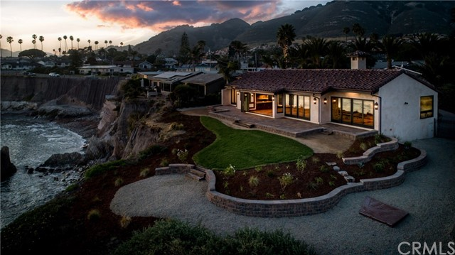 Private Ocean Front Estate! Over 17,000 sq. ft. lot is one of the largest ocean front lots in Pismo Beach and provides unsurpassed privacy while boasting top of the line amenities. This home has been remodeled from the ground up and no expense was spared. The home showcases 3 bedrooms, 4 full baths of single story living and is custom throughout. New windows, new doors, Saltillo tile flooring inside and out, new Viking appliances, custom granite in kitchen and bathrooms, one of a kind custom cabinetry and bathroom vanities. New lighting, ceiling fans, as well as brand new fireplaces. Custom wine cellar with amazing finishes of distressed wood, brick and stone that is temperature controlled. Home was finished with a brand new garage door, roof, and copper gutters! All outdoor landscaping was redone and is up to code, with low drip sprinklers, new hardscape with brand new paver patio landings. Layout of home was redone and is a must see. If you are looking for a unique ocean front property, this is a must see! Own your own paradise! This gorgeous, luxury home is one of a kind with views that are unmatched!