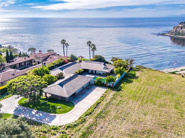 "Extremely rare offering and an opportunity to build your dream home in a location that rarely emerges. Close to an acre bluff top lot(BTV) on the most prestigious street in all of Palos Verdes. The original owners are presenting this property for the first time in over 50 years. The home looks down onto the extraordinarily beautiful and legendary ""Lunada Bay"" with it's wind carved cliffs and shoreline. Natures artwork sculpted by centuries of forceful effort. The home sits next to parkland, offering privacy and additional light and open space which makes it rarer still.  The current [over 3700 Sq Ft (BTV)] residence is almost entirely on one level. This offers exceptional opportunities to reimagine and add to the existing structure with its 5 bedrooms and 3.5 baths. Just past the Meditation Garden sits the pool in the enclosed entry courtyard. There is also a large circular driveway and a 4 car garage.  The terraced backyard would accommodate a pool and large entertainment area.  The visuals and sounds are a delight to the senses and you are drawn into the calmness of nature's extraordinary canvas. An opportunity that may appear only once in a lifetime and claimed by only a few. These notices are the rules of entry per CA regulations: https://tinyurl.com/VistaSIRRulesofEntry"