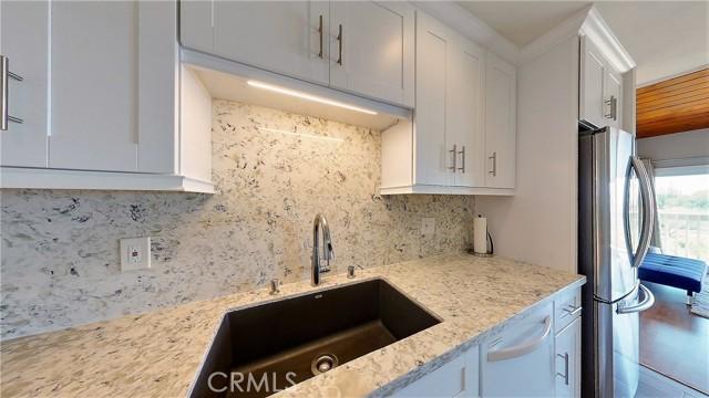 Newer granite kitchen sink with quartz counter tops.