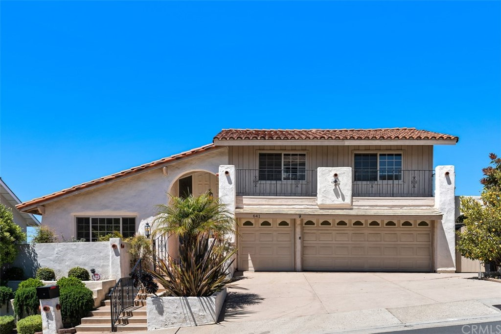 BREATHTAKING PANORAMIC OCEAN VIEWS!  Come live the San Clemente beach-style way of living and watch the seals as they play on Seal Rock. High above beautiful San Clemente with forever views and perfectly situated on a single-loaded street is this 4-bedroom, 3 bath home with a generous size formal living and large dining room and views from practically everywhere you look.  Perfect for the home office, gym, or for your guest is a downstairs bedroom with a nearby full bath down the hall.  The spacious kitchen offers a gas range, double ovens, plenty of storage, and a window to watch the sun go down as you prepare your favorite meal.  Adjacent to the kitchen is the large family room, fireplace, a wet bar for entertaining with spectacular views of Dana Point Harbor, and more. The breeze alone is beyond relaxing.  A separate and more causal area is off the kitchen for more casual meals.  Upstairs you'll find the master suite with a double door entry, OCEAN VIEWS off the balcony, a walk-in closet, dual vanities, and a walk-in shower. There's also a surprisingly huge storage room to keep all the bare necessities of life handy.  Down the hall, you'll find two additional good-size bedrooms with closets and ceiling fans.  An additional full bath upstairs, convenient linen cabinets complete the second level.  Low maintenance backyard with artificial turf, gas fire-pit, and the most majestic sunsets you'll ever see!  Enjoy picking from the delicious Lemon, a wonderful Macadamia Nut, and Clementine trees.  Gather with friends around the gas firepit and bring your table and chairs to enjoy the views.  Large side yard, and a spacious two-car garage. Pictured are three, but the third garage is used as a work area/storage room. San Clemente is the perfect spot for a SoCal summer getaway.  It's located in the southern part of Orange County, right before you hit San Diego. San Clemente has a laidback beach town vibe with some of the best beaches in the state, especially if you want to