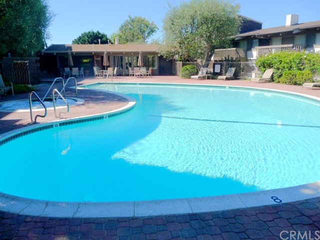 Large pool and jetted spa adjacent to the club house
