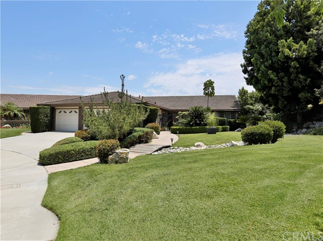 Situated at the end of a cul de sac this lovely home is in move-in condition. The common green belt gives this home a parkland setting. The home has Views from the kitchen and back yard. A custom built bar is perfectly placed in the family room. The formal dining area looks down on the sunken living room. The living room with a fireplace gives a peaceful serene space to the home. The backyard has a nice patio with a pool and spa and water features. The master bedroom is located away from the rest of the bedrooms with its own fireplace and access to the pool and spa. The master bathroom  has access to a private outside garden. A laundry room leads you to a full sized 3 car garage. This home has recently installed solar as a added benefit. Make this fine four bedroom three bath your home.