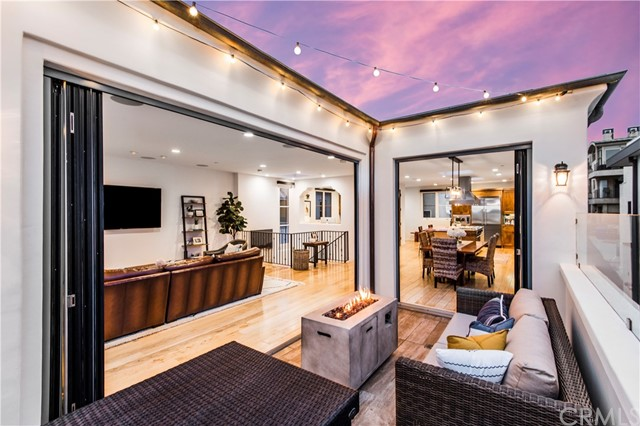 Panoramic doors open the living space up to the outdoor deck.