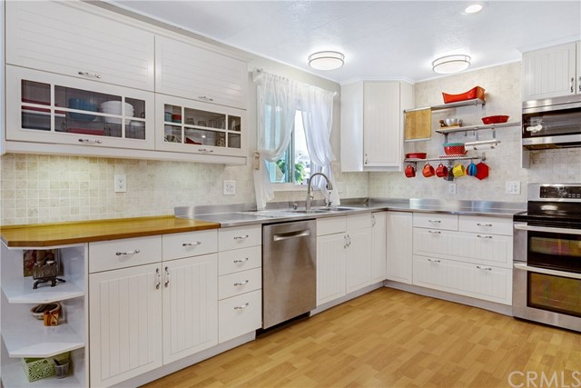 Upgrades include stainless steel Appliances, stainless steel counter tops & butcher block, Bosch dish washer, Electric double oven, microwave and upgraded Cabinetry