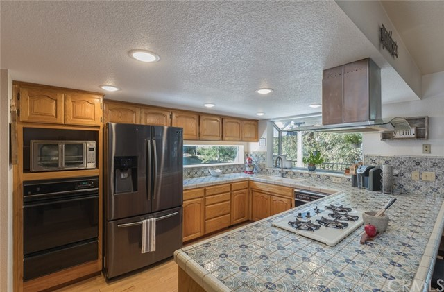 Natural lite kitchen with Italian tile counters.