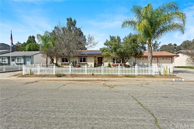 """FABULOUS SINGLE STORY with SOLAR & NO HOA on ½ ACRE lot with huge 368 SF bonus room plus a 3 car garage. Bring your RV, horses & toys to sprawl out on this completely usable, fully fenced property. Open floor plan home with laminate flooring throughout, ceiling fans in every room, walk in shower in master bath & spacious kitchen with large island make this a must see.  Furnace, A/C unit, Milgard tinted windows & water heater all recently replaced.  Don't forget about the amazing 368 Sq. Ft. Man-Cave that makes this home almost 1900 Sq.Ft.    32 Panel Solar system which will be paid off at close of escrow.  Huge 21' x 53' green house, complete with a 300 gallon water tank and three 55 gallon barrels with RO system make it ready to grow anything you want. Large pen and 2 large covered horse stalls that could be divided into 4-6 smaller ones. Gated RV parking with 30 amp hook up, white picket vinyl fencing in front yard, storage shed, 4 large raised garden beds, RC Car track, fruit trees, large covered patio, 6"""" gutters and 8 camera surveillance system top off the exterior features of this amazing home. surrounded by the beautiful mountain landscape. NO HOA & LOW TAX!"""