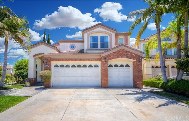 Mediterranean style dream home located in the Gallery Collection community of Fullerton.  Situated on a corner lot within a cul-de-sac street, this magnificent property features cathedral vaulted ceilings, 4 spacious bedrooms (including a downstairs bedroom), 3 full baths, and a pool.  Exceptional layout with abundant natural light, separate living room, family room, and dining room.  Large kitchen with plenty of cabinet space, dual ovens, granite counters, and a large window peering out to the beautiful backyard with pool.  All the bedrooms are very spacious and the downstairs laundry is equipped with a separate sink.  Very private location within a gated community, this home is a corner lot on a cul-de-sac street with only a handful of homes and no house directly in front.  Don't miss out on this great opportunity!