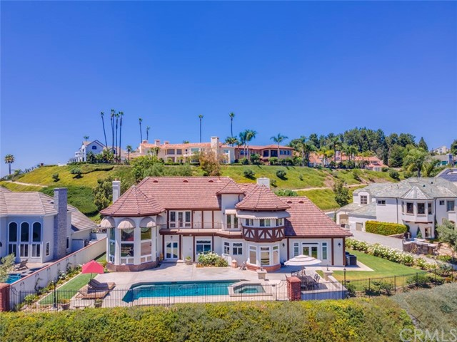 Welcome to 3214 East Woodbine Road, this meticulously maintained 5,300 sq fthome is located in the private guard gated community of Hillcrest. Sitting on one of the best streets in Hillcrest and nestled beautifully into the hills of Orange, you can admire year round sunset views with Catalina Island and Palos Verdes in the distance and twinkling city lights at night. Enter the home through a grand entrance to a formal dining room, game/bar room, and living room. The chef's kitchen features high-end appliances and views of the serene pool. Several rooms including the family room open to the lush landscaped main yard which offers a perfect location for entertaining with the refreshing breeze flowing through. The quality craftsmanship and attention to detail offered throughout the floor plan allows for carefree living or elegant entertaining. All four generously sized bedrooms are located on the second level; the master suite boasts a rare oversized walk-in closet, office/gym space, and a bonus storage room.In addition to the many wonderful highlights, the spacious backyard has views as far as the eye can see, a grassy area, a sparkling pool/spa, and a raised patio.A three-car garage completes this fabulous home; no detail has been overlooked in this immaculate move-in ready opportunity.