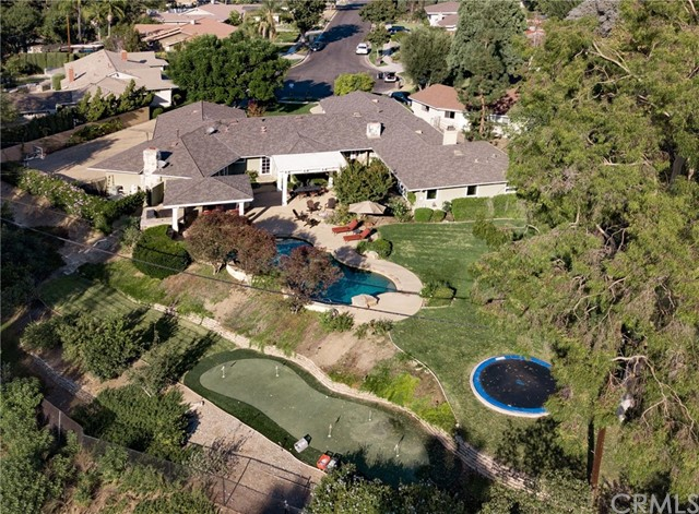 SPECTACULAR SINGLE STORY Fullerton home on cul-de-sac with view of Fullerton Golf Course on a spacious lot of over 29,000 Square Feet, .69 acres! 4 bedrooms+ bonus room with over 4,331 sq. feet of spacious living with updates around every corner! This home features a bright and open floorplan with recessed lighting throughout, two HVAC units, built in cabinetry and ceiling fans. Gourmet kitchen with Thermador 6 burner/griddle range, stainless steel appliances, kitchen island that is open to the breakfast nook and sitting room w/ stone fireplace. Spacious Master Suite features walk-in closet, fireplace, large walk-in shower, separate jacuzzi tub and double sinks with vanity. Two of the three additional bedrooms include built in desks and double closets. The LARGE family room features a built -in entertainment center, fireplace, and direct access to the SPECTACULAR backyard. This backyard is built for Entertaining. It features BBQ island with refrigerator and sink, beautiful Pool with spa, two covered patios, firepit that is perfect for any family BBQ, custom in-ground trampoline, putting green and view of Fullerton Golf Course. Home also includes spacious updated 3 car garage with room for RV or Boat in driveway. NO MELLO ROOS OR HOA. Conveniently located close to Fullerton Golf Course, Laguna Lake Park, restaurants, shopping and entertainment. Come view this beautiful home and make it yours today.
