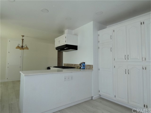breakfast bar & nook + wall of cabinets