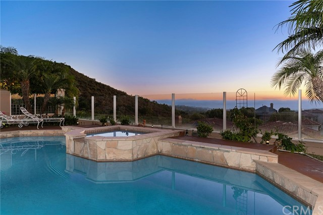 Backyard with pool, spa with waterfall feature, and panoramic views of Catalina, coastline and east to the mountains. You can even see the Disneyland fireworks (when they happen again!!).