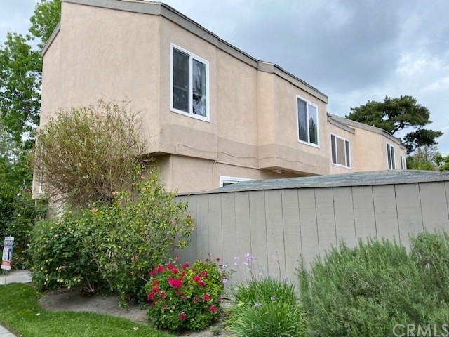 Side of Townhome and enclosed  large private patio
