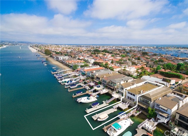 FROM EXPERIENCING HARBOR VIEWS TO RELAXING AFTERNOONS ON THE WATERFRONT, THIS BEAUTIFULLY UPGRADED BAY FRONT HOME OFFERS A MAGNIFICENT SETTING ON NEWPORT BEACH'S EXCLUSIVE LIDO ISLAND.  INDOORS, MASSIVE WINDOW EXPANSES CAPTURE BAY, MOUNTAINS AND CITY LIGHT VIEWS FROM NEARLY EVERY ROOM IN AN OPEN CONCEPT. TWO STORY FLOOR PLAN THAT EXTENDS APPROXIMATELY 3,121 SQUARE FEET. ENJOY 4 BEDROOMS AND FOUR BATHS, A LIVING ROOM WITH AN ELEGANT STONE FIREPLACE, A SPIRAL STAIRCASE AND A SECOND FLOOR GREAT ROOM THAT CAN BE CONVERTED INTO ONE OR TWO ADDITIONAL BEDROOMS. A REMODELED KITCHEN SHINES WITH STONE COUNTERTOPS, CUSTOM WOOD CABINETRY, A BREAKFAST BAR AND STAINLESS STEEL APPLIANCES.  THIS BRIGHT AND MOVE-IN READY RESIDENCE REVEALS A STYLISH MASTER SUITE WITH FOREVER VIEWS OF THE BAY.  A LARGE 2 PLUS CAR GARAGE AFFORDS SPACE FOR YOUR GOLF CART AND/OR MOTORCYCLE.   THE PRIVATE EXISTING LARGE DOCK HAS APPROVED PERMITS FOR EXPANSION.  RESIDENTS OF LIDO ISLAND REAP THE REWARDS OF ACCESS TO PRIVATE BEACH, SAILING, TENNIS AND SOCIAL CLUB.  JUST A SHORT WALK AWAY THE NEWLY RENOVATED LIDO MARINA VILLAGE WITH SHOPS, RESTAURANTS AND ENTERTAINMENT.  THIS BEAUTIFUL BAY FRONT HOME IS READY FOR IMMEDIATE POSSESSION AND OCCUPANCY.