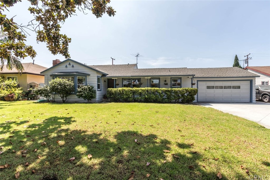 HUGE PRICE IMPROVEMENT on this charming single-story home that awaits your vision & design talent to transform it. It's been well-loved & well-maintained & is ready for your personal touches. Everything is functioning & comfortable, just needs sprucing up.  Newer AC unit, dual-pane windows, roof & whole house fan are just a few of the BONUS features of this special home. With its appealing front curb appeal & extra-long driveway this home will surely delight the entire family. Step inside & find 4BDRMS, 1 full bath with an adorable vanity & 1 3/4 bath with a walk-in shower. The living room is adorned with a wood-burning fireplace & picturesque windows overlooking the front. The separate dining room is good in size & is complimented with a precious chandelier.  The kitchen is light & bright with a cozy nook area, a stainless-steel refrigerator, oven, electric stove & dishwasher & is open to a room that can easily be a den/office/craft/sewing or play area. Gather with friends & family in the HUGE family room with a second fireplace & separate entrance with a convenient sliding glass door with access to backyard. SWIMMING POOL, basketball hoop, playhouse, multiple storage sheds to store all your outdoor gardening tools are just a few of the WOW features of the backyard. The two-car direct access garage has a plenty of storage, utility sink, washer/dryer, which are all included with the home. No HOA & in close proximity to Santa Ana College, shopping, restaurants & freeways.