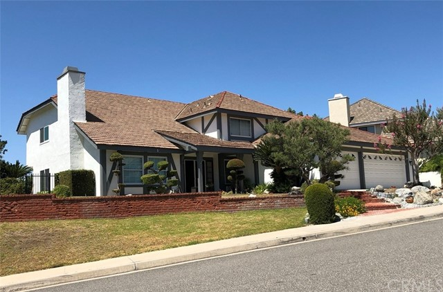 Stunning executive home in desirable Hunters Pointe in Anaheim Hills, highly upgraded and renovated throughout. Ample wide windows bring in lots of natural lighting. The entire house  freshly painted inside and out with newly installed recessed ceiling lights. Highly desirable open floor plan features main floor bedroom/office with open closet & bathroom with 4 bedrooms & 2 bathrooms upstairs, It includes all the sought-after amenities including new screened double door entry, tile floors, new carpets, neutral paint, double-pane windows. Vaulted ceilings open to a formal dining room, Large family room has a custom fireplace and built-in cabinets, Newly upgraded/remodeled kitchen with granite counters, center island and stainless steel appliances, there is a large laundry room and remodeled main floor bathroom with a shower. The spacious master suite with vaulted ceilings and remodeled bathroom, large walk-in closet. Walk out to the 2nd story deck overlooking a view with a serene & private back yard featuring a large sparkling pool and spa with a diving board.  Under the deck is a large patio for entertainment and gatherings with family/friends. There is a spacious oversized 3.5 car garage. This home is truly remarkable! just a block from Walnut Canyon Reservoir for jogging, walking and biking. excellent school district. Conveniently located to free ways, shopping, restaurants and library. Low HOA