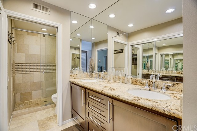 The same Elegant features flow through your Master Bath with a Frameless Glass Shower, Custom Soft-Close Cabinets & Counter to Ceiling Mirrors