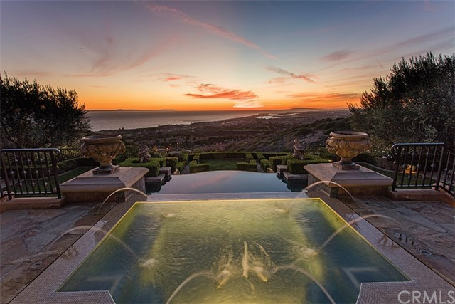 Arguably the finest estate publicly offered in the Newport Coast, 7 Pelican Vista showcases timeless beauty and design around every corner with unparalleled views of Newport Harbor, California coastline, and the Pacific Ocean with Catalina resting in the backdrop. At just over 11,600 sqft with over 3,000 sqft of covered loggias positioned on a peninsula lot just under 30,000 sqft this estate boasts 5 full suites, 11 bathrooms and every amenity one could wish for. From the moment you enter the estates fronArguably the finest estate publicly offered in the Newport Coast, 7 Pelican Vista showcases timeless beauty and design around every corner with unparalleled views of Newport Harbor, California coastline, and the Pacific Ocean with Catalina resting in the backdrop. At just over 11,600 sqft with over 3,000 sqft of covered loggias positioned on a peninsula lot just under 30,000 sqft this estate boasts 5 full suites, 11 bathrooms and every amenity one could wish for. From the moment you enter the estates front gates through the sunken Italian gardens you are transported to the most private property in the community. Throughout, custom millworks, Fine wood and stone floorings, exquisite moldings crafted by artisans and adorned with authentic antiques and bespoke furnishing, artifacts and art this property is built for the most discerning clientele. The grounds offer amenities stretching from the JBL Home theater, billiards room and multiple spas to heated floors, automated shades, and state of the art security system just to name a few. To fully comprehend the quality and craftsmanship this estate must be viewed with the naked eye. 7 Pelican Vista epitomizes coastal resort living with no expense of authentic detail spared.