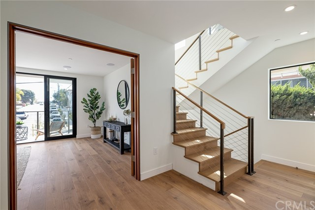 Grand double doors open to master suite with private balcony (shown here using reverse of 961 Unit A staging)
