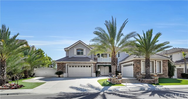 Coming Soon, full photos to come: Welcome to 3453 Gardenia, an elevated Toll Brothers construction, Mediterranean inspired estate, located in the Pinnacle community of Vista Del Verde, high atop the hills of West Yorba Linda. Panoramic views of this caliber are not easily found, especially with the accoutrements and amenities this home offers. The community name of Pinnacle is befitting for such an estate, both in location high above, and in a lifestyle elevated. Entertainers seek dream homes like this, spacious both inside and especially out, with swagger only it can provide. Indoor/outdoor SoCal living is epitomized here, centered around the chef's outdoor kitchen, complete with custom seating, professional cooking, and covered and headed to enjoy every day of the year. Views both day and night from the Los Angeles skyline, to Newport beach, Catalina, and everything in between. Inside, six bedrooms plus an office accommodate all, with seven bathrooms and room to live lavishly and comfortably. Monogram stainless steel appliances with gas burner cooktop, elite hood vent, double ovens, two dishwashers, and warming drawer, with built in refrigerator. The home has a sentiment of warmth and joy, with multiple fireplaces, natural light illuminating the home, balcony off the primary bedroom to enjoy fireworks shows, city lights, and a serenity enviable by most. The primary bedroom is a peaceful retreat, with built-ins, a tremendous closet, and bathroom offering dual sinks, make up vanity, jacuzzi tub, twin toilet rooms, and a shower with room for two or more. Back outside, the wrap around flagstone and painted concrete hardscape lend to dinner parties, get togethers, and events that can exceed 200 guests (as it has many times), all centered around the pool, spa, multiple firepits, food, fun, and memories in the making. Make this the home where your memories last forever!