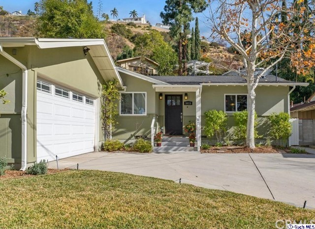 Welcome to this bright and cheery single-level home nestled at the foothills of the desirable Crescenta Highlands Neighborhood. Located on a cul-de-sac, this home offers privacy, comfort and picturesque mountain views. The property features a spacious living room with a cozy fireplace and beautiful hardwood floors. There is plenty of natural light that illuminates the entirety of the space. A sliding French door leads to the charming backyard where the drought tolerant landscape and deck offer the ideal setting for outdoor living and entertaining. The gourmet kitchen features custom cabinetry and stainless-steel appliances including a 28-bottle wine cooler. The island bar seating is great for a quick morning breakfast. This home offers a spacious family room with a skylight and ceiling fan. The primary bedroom features recessed lights, a ceiling fan and sliding French doors leading to the backyard. The primary bath offers a dual sink, shower and walk-in closet with plenty of storage. The second bath offers a dual sink, recessed lights, a Hydro system bathtub, skylight and storage. Additional features include a basketball court, laundry closet with custom cabinetry, a sink, recessed lights and a vent fan. There is beautiful hardwood floor and crown molding