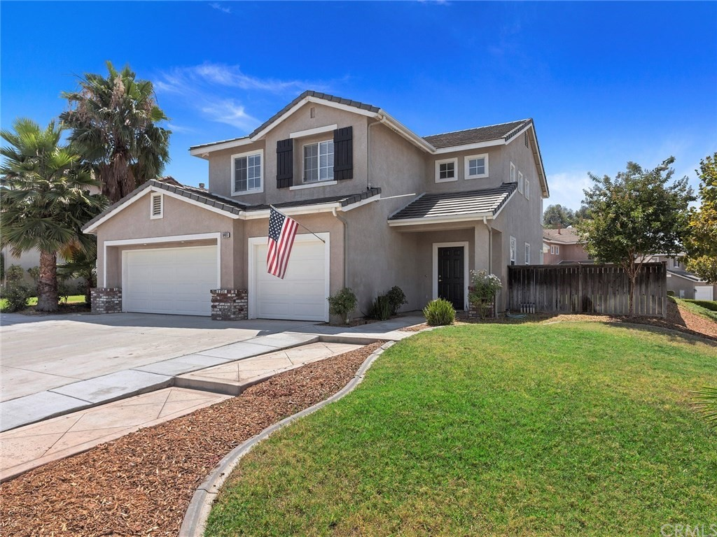 PRICED TO SELL...Fabulous Corner Lot (approx 7,405 sqft.) with a 3 CAR GARAGE located across from the Orange Terrace Community Park . This move in ready home is light and bright and features brand new carpet, new paint throughout with LED lighting. Gourmet kitchen offers tile floors with gas range with microwave, designer counters and nice size butcher block island. Off the kitchen is a comfortable family room with fireplace. Downstairs bedroom/office area along with a separate laundry room. When you travel upstairs you will find a large loft/bonus room area that can be used as a TV room, pool room, play area for the kids and spending time with the family. Large master bedroom with dual vanity and separate separate shower and tub. This model features 2 additional upstairs bedrooms with beautiful wainscoting and designer paint. Large backyard with patio cover. Low tax rate at 1.11871%