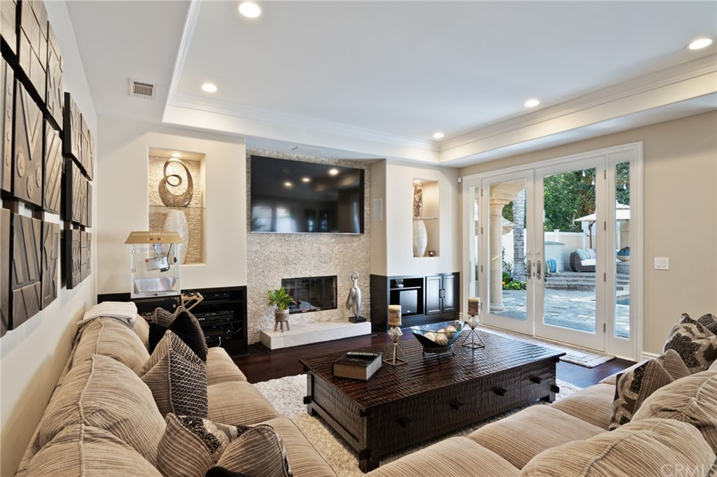 Family room with fireplace and custom built-in entertainment with stone.