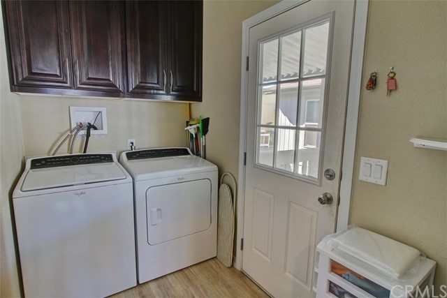 Laundry Room with Exterior door to Carport and Shed.  Beautiful Cabinetry and a Pantry.