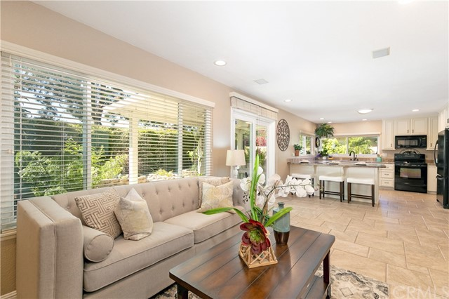 Step into one of the most tastefully upgraded newly renovated homes in the Greentree neighborhood of Irvine! This gorgeous 4 bedroom , 3 bathroom home is located on a cul-de-sac and backs to Greentree Elementary's large open playground with no homes behind. This large almost 5000 SF lot is nicely appointed with lush green grass, covered patios and a long driveway. Enjoy the high ceilings and open feeling as you enter the home. The Kitchen is upgraded with granite counter tops, sit up breakfast bar and double pane wrap around windows with views to outside. Experience the backyard oasis including a variety of fresh trees, a covered patio, lush greenery, and a fountain creating a perfect space for entertaning! Double pane windows bring in plenty of natural light throughout the 2400 SF living space. Upgrades include downstairs expanded family room, custom porcelain and oak wood flooring, upgraded bathrooms and Surround Sound speakers. Unwind in the expanded master bedroom suite and remodeled master bath with his and her walk-in closets. Three additional bedrooms with full bath compete the upstairs.Two car attached garage. Downstairs inside laundry room. Low HOA fees- $65. Low Taxes. No Mello Roos. Homeowners enjoy community pools, spa, BBQ, and sport courts. Home is ideally located in the heart of Irvine, walk to  award-winning Irvine schools.short to drive to UCI. Shop at Trader Joes, 99 Ranch and enjoy amazing dining and entertainment close by.