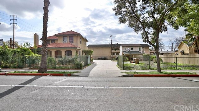 Location! Location! Impressive corner lot size of 15,311 sqft located in the city of Anaheim with 2 separate units. Only 2 miles to Disneyland. The historical 2 story main house with 1,819 sqft has 3 beds , 2 baths and the detached guest house has 1 bed, 1 bath and attached two car garage. Both buildings are now for rent and have separate electric meters. Nice looking gazebo in the back yard with large parking up to 6 cars plus the 2 car garage. There are a lot of flowers and fruit trees in the huge yard, private gate entrance. It's ideal for the new construction or even just for rental income. IT IS SOLD AS IS - NO REPAIR - NO TERMITE