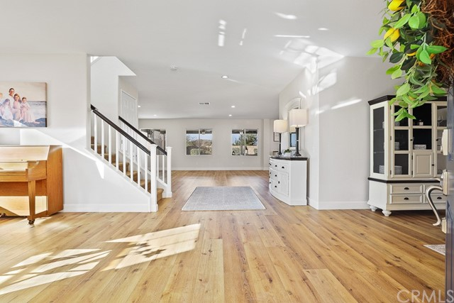 Updated new LVT waterproof flooring throughout the entire downstairs. Freshly painted interior and railings.
