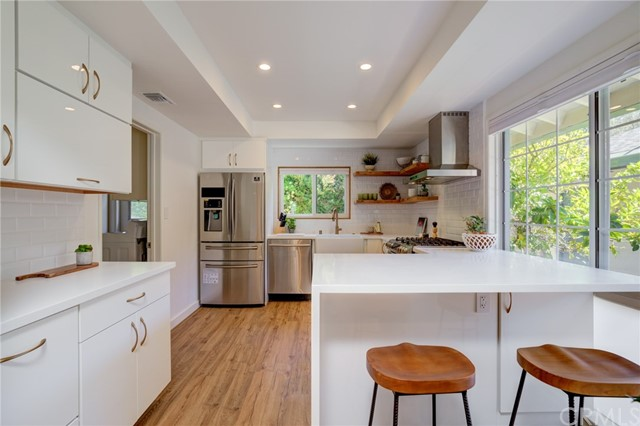 Updated kitchen with breakfast counter and stainless steel appliances