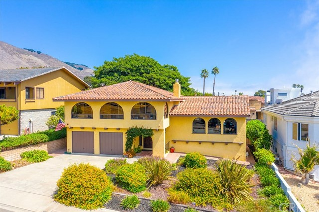 Wonderful Shell Beach home on Huge lot with ocean views from entire front of house. Open kitchen with custom cabinets, Thermador 6 burner stove, dishwasher and built in refrigerator with custom wood panels. Back patio deck off dining great for entertaining and BBQ's. Living room has custom gas fireplace and open staircase. Three bedrooms upstairs all have access to the front enclosed sun deck with expansive ocean views. Bathrooms have been recently renovated. The back of the house has a large family room with wet bar and 12 foot sliding door leading to the beautiful backyard. From the back gate you can walk to Eldwayen Ocean Park for a beautiful sunset.