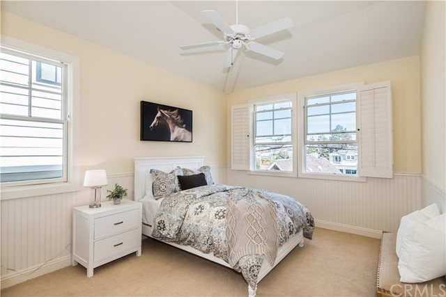 Spacious Bedrooms with Wain Scoting, Vaulted Ceilings, and Ceiling Fans